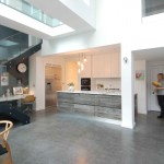 Kitchen with hidden door to utility and sun aged solid oak cladding to the island